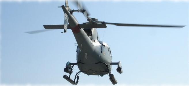 UH-12 Esquilo armado com lançador de foguete.