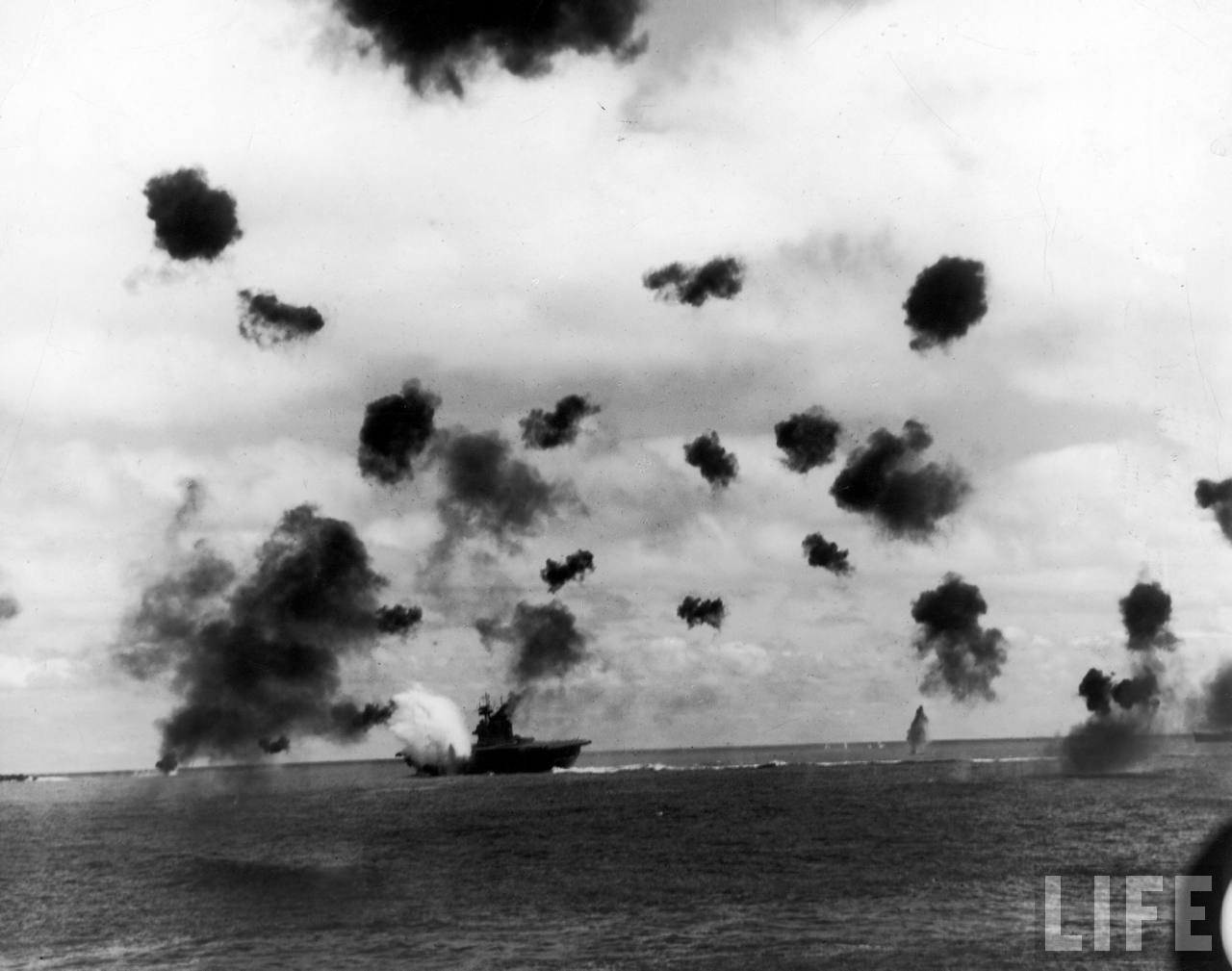 smoke-from-antiaircraft-guns-fills-the-sky-as-aircraft-carrier-uss-yorktown-rear-c-is-hit-by-a-japanese-torpedo-during-the-battle-of-midway