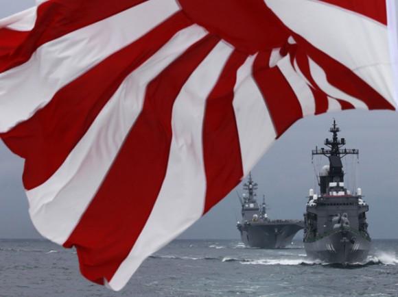 Japanese Maritime Self-Defense Force destroyer Kurama leads destroyer Hyuga during a naval fleet review at Sagami Bay, off Yokosuka, south of Tokyo