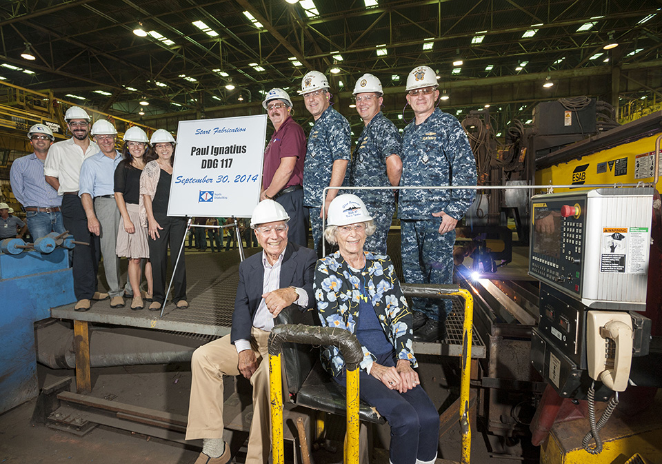 Paul and Nancy Ignatius (seated) attended the start of fabrication ceremony for Paul's namesake ship, the guided missile destroyer DDG 117