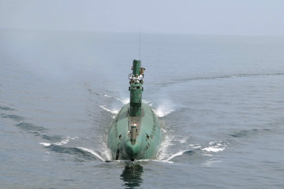 North Korean leader Kim Jong Un (front) stands on the conning tower of a submarine during his inspection of the Korean People's Army (KPA) Naval Unit 167 in this undated photo released by North Korea's Korean Central News Agency (KCNA) in Pyongyang June 16, 2014. REUTERS/KCNA (NORTH KOREA - Tags: POLITICS MILITARY MARITIME)  ATTENTION EDITORS - THIS PICTURE WAS PROVIDED BY A THIRD PARTY. REUTERS IS UNABLE TO INDEPENDENTLY VERIFY THE AUTHENTICITY, CONTENT, LOCATION OR DATE OF THIS IMAGE. FOR EDITORIAL USE ONLY. NOT FOR SALE FOR MARKETING OR ADVERTISING CAMPAIGNS. THIS PICTURE IS DISTRIBUTED EXACTLY AS RECEIVED BY REUTERS, AS A SERVICE TO CLIENTS. NO THIRD PARTY SALES. NOT FOR USE BY REUTERS THIRD PARTY DISTRIBUTORS. SOUTH KOREA OUT. NO COMMERCIAL OR EDITORIAL SALES IN SOUTH KOREA