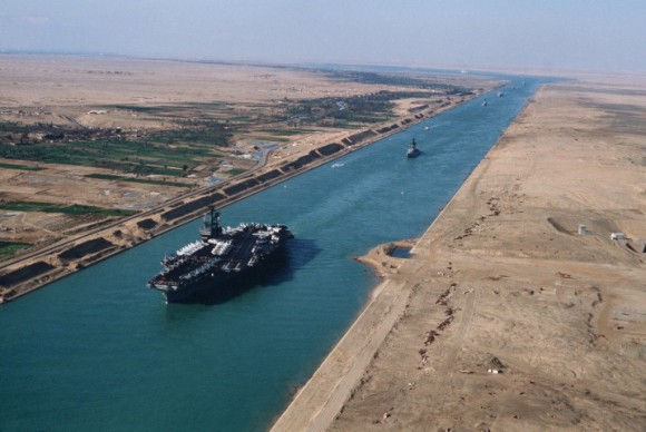 An aerial port bow view of the aircraft carrier USS AMERICA (CV 66) during its transit through the canal.