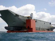 Futuro TCG Anadolu sendo transportado para a finalização da construção