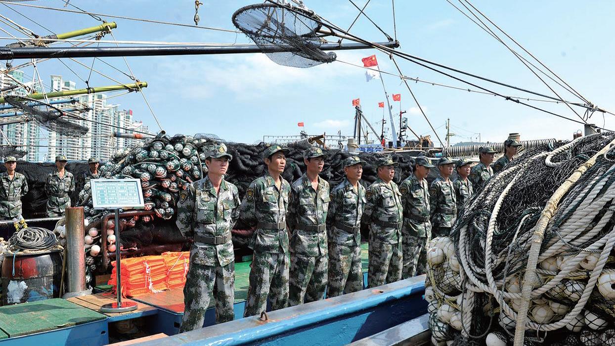 Milícia marítima chinesa trabalha ems barcos de pesca