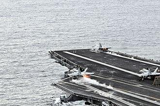 330px-US_Navy_081124-N-3659B-305_F-A-18C_Hornets_launch_from_the_Nimitz-class_aircraft_carrier_USS_Ronald_Reagan_(CVN_76).jpg